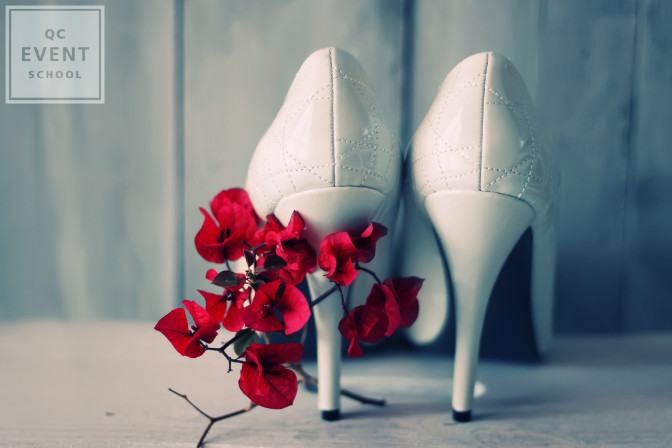 heels with red flowers for the bride on her wedding day