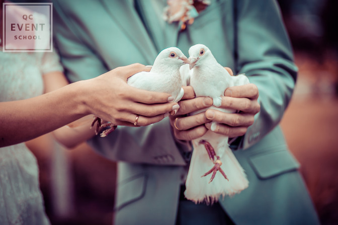 doves held by the bride and groom on a wedding day as part of wedding tradition