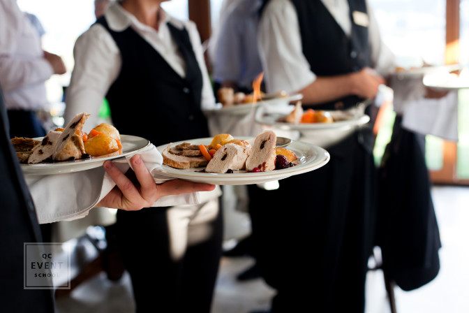 formal event with waiters serving plated meals catering services