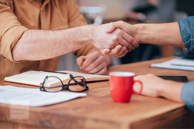 shaking hands in agreement with another event planning industry vet