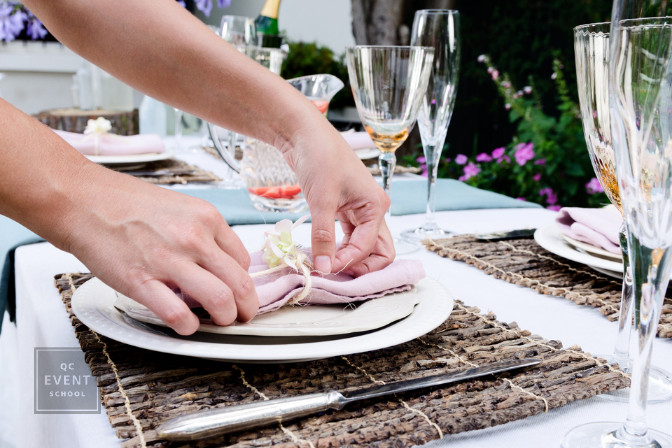 party planner fixing table setting