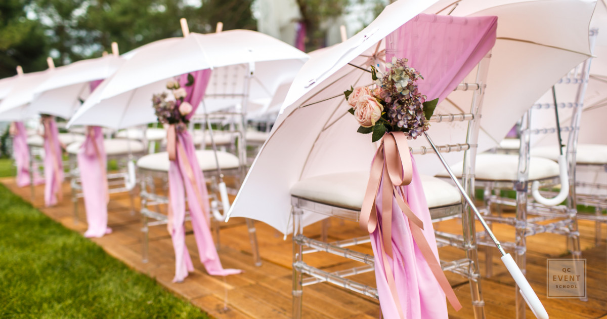 wedding ceremony event planning decor with pink umbrellas in the forest
