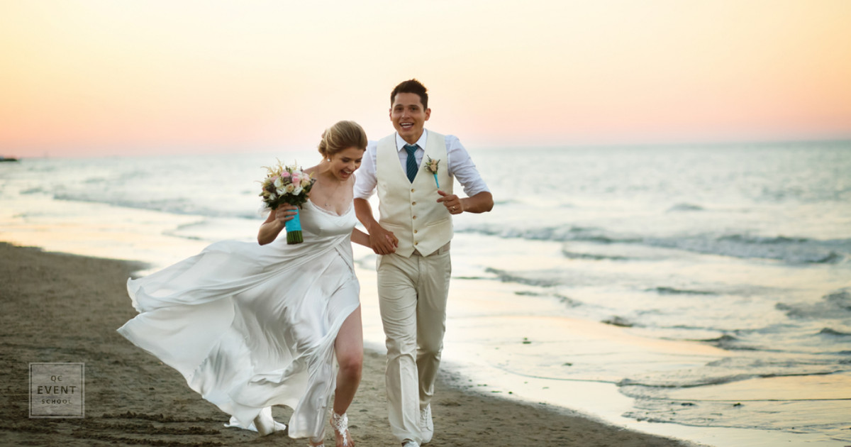 destination wedding planning trends for 2019 couple running on beach
