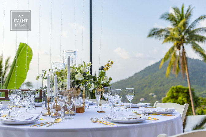 beach side wedding reception next to palm tree wedding planning