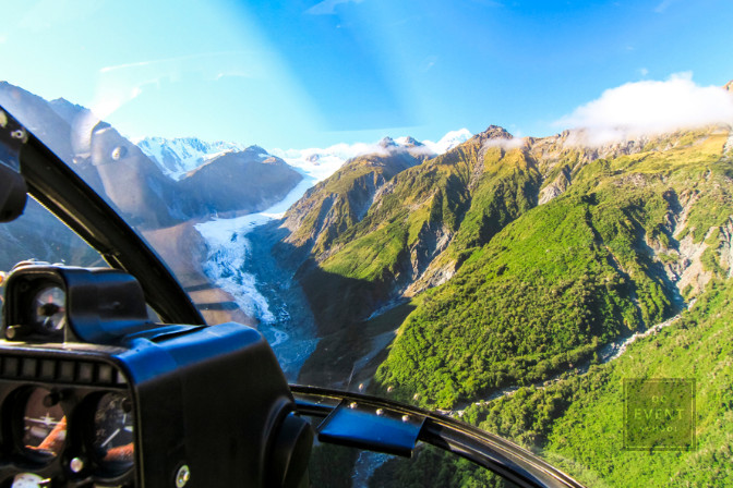 helicopter flying over fox glacier in new zealand for a LGBTQ friendly wedding