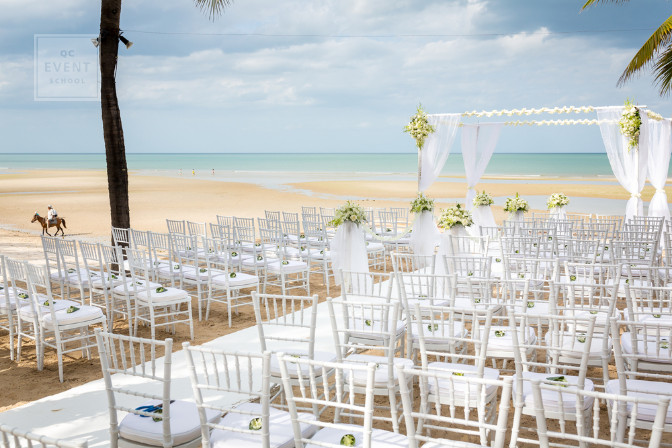 outdoor wedding ceremony on the beach doesn't have much floral design - destination wedding planning tips
