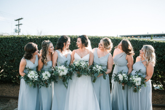 Jenna Parcher Willa and Rose Event and Wedding Planning group of bridesmaids with bride