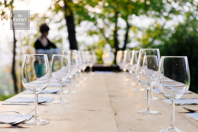 wine glasses on dinner table outdoors - planning an outdoor event