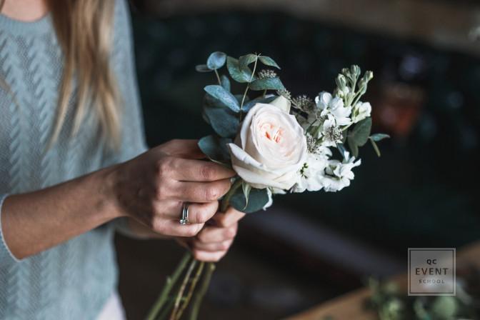 wedding florist vendor putting together floral event decor