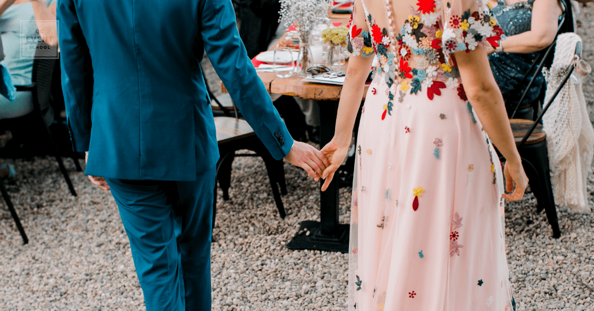 wedding business - bride and groom holding hands