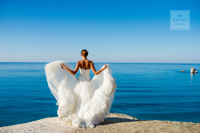 destination wedding bride on cliff