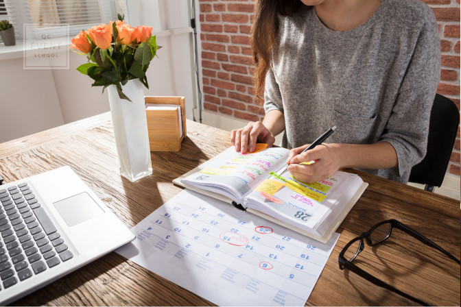 event planner writing in planning notebook
