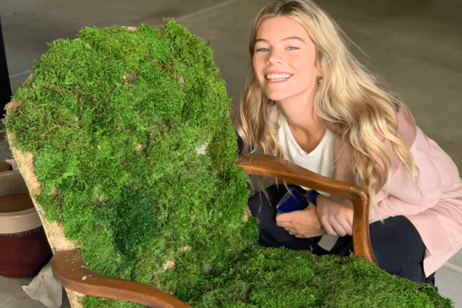 mady bell with handmade chair covered in moss