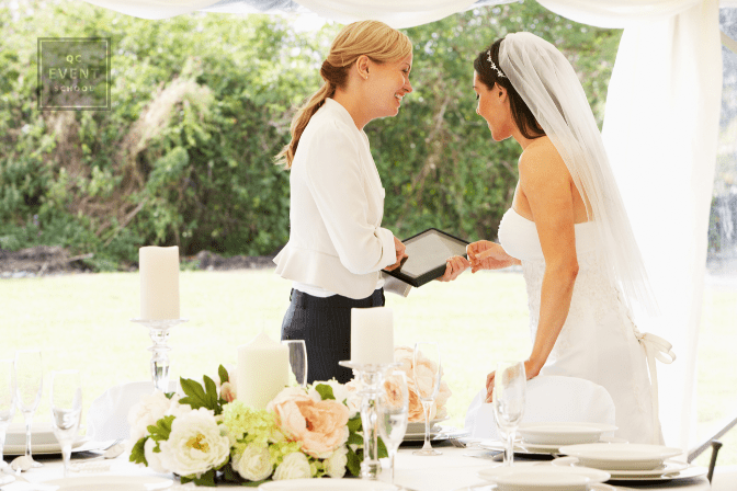 wedding planner speaking with bride