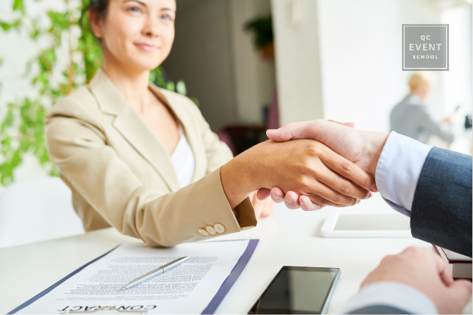 business woman shaking hand after contract agreement