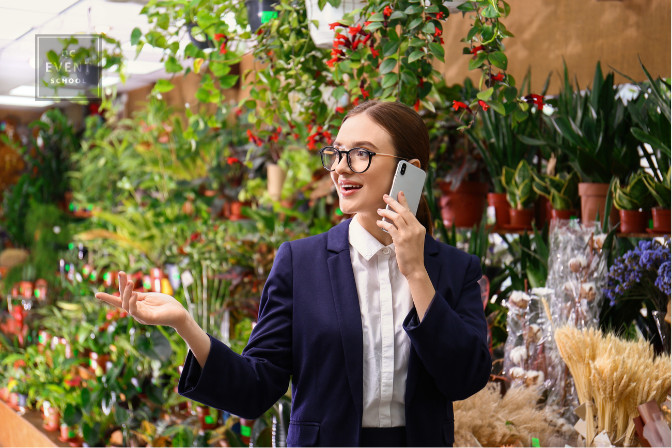 female event planner on phone in floral shop
