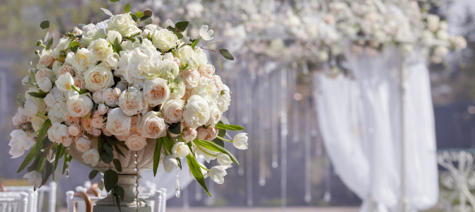 wedding bouquet with arch in background