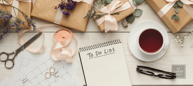 notepad with 'To Do List' written at top, surrounded by wedding decor
