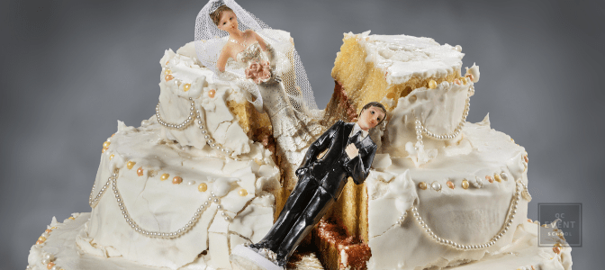 ruined wedding cake with bride and groom toppers stuck in the middle