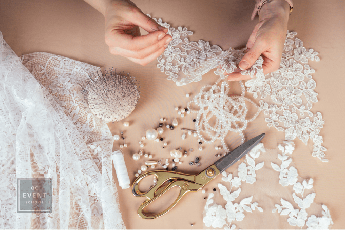 wedding dress and hands fixing with sewing supplies