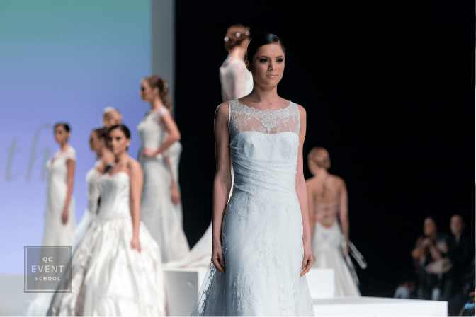 models wearing bridal gowns on runway at bridal show