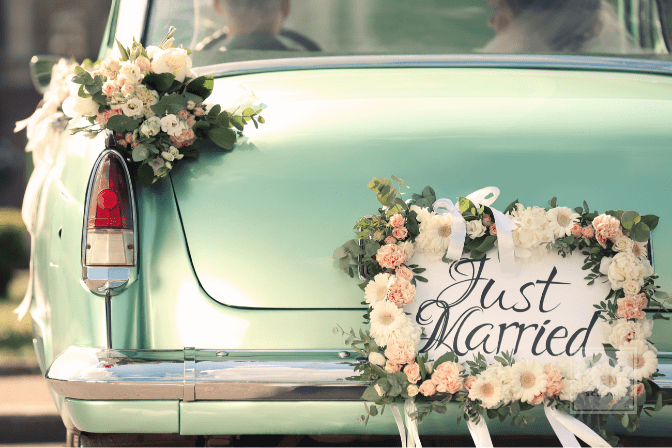 back of green cadillac, just married sign