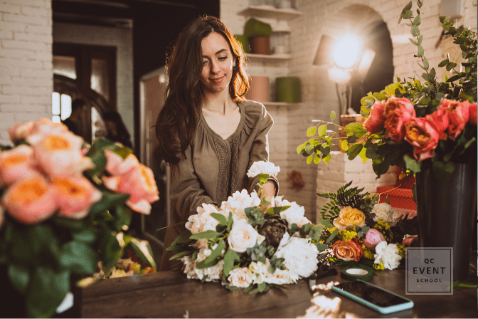 girl creating bouquet in floral shop