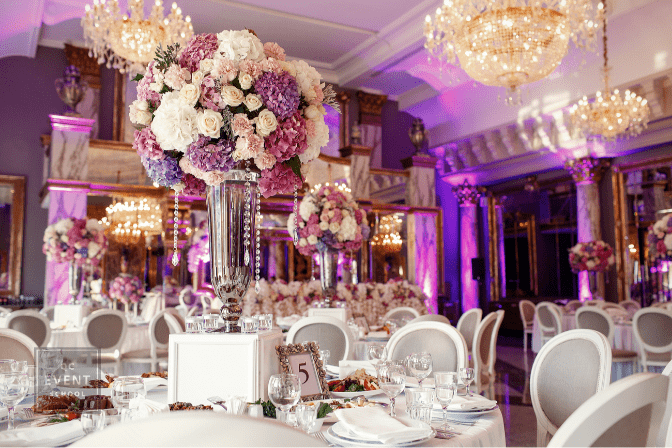 Table number 5 decorated with pink and violet hydrangeas and served with sparkling glassware