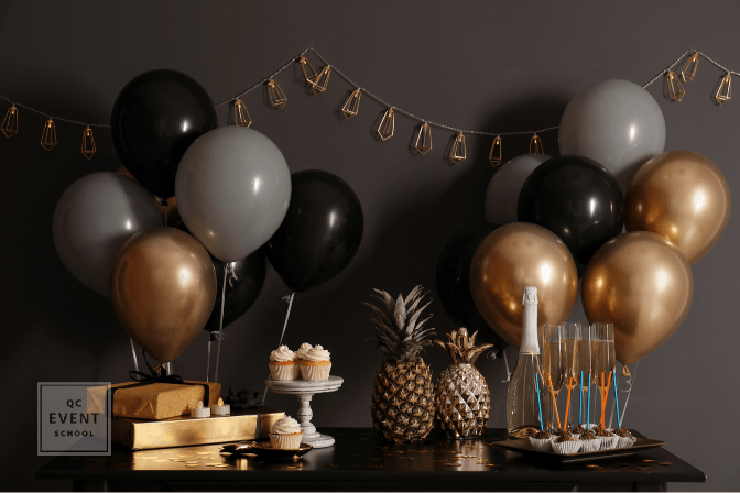 Party treats and items on table in room decorated with balloons
