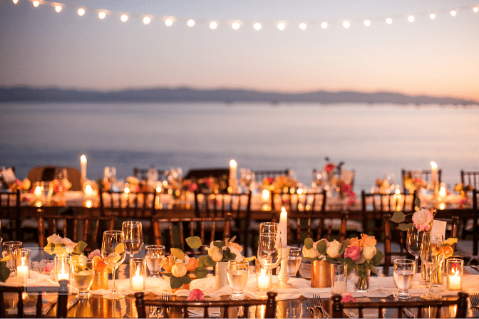 destination wedding, amazing dinner table setup in front of ocean backdrop