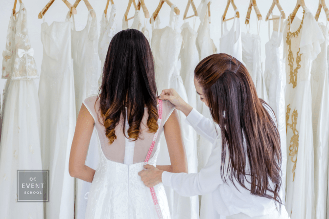 Staff measuring bride dress for cut wedding dress. Marriage concept.
