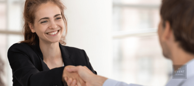 corporate event planner shaking client's hand
