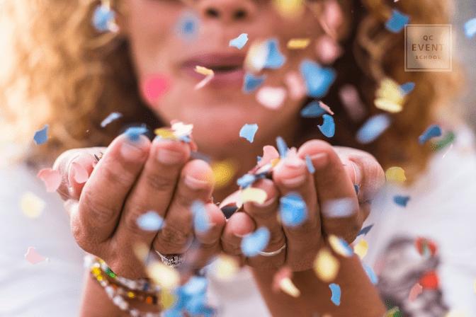 up close shot of woman blowing confetti