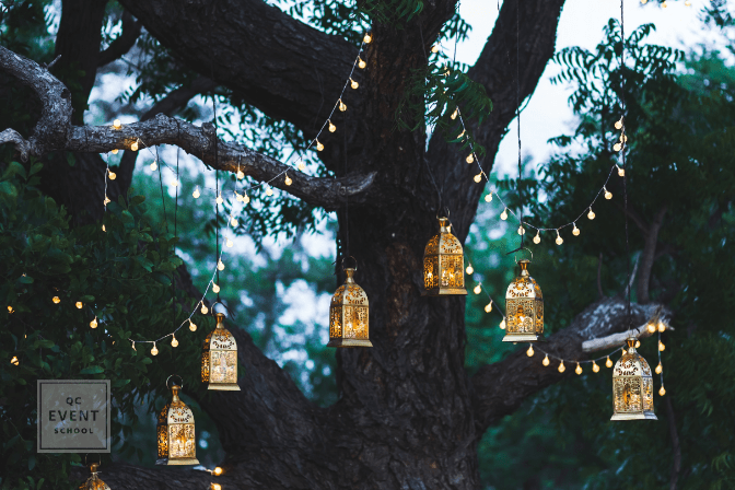 event decor lanterns and lights hanging from tree