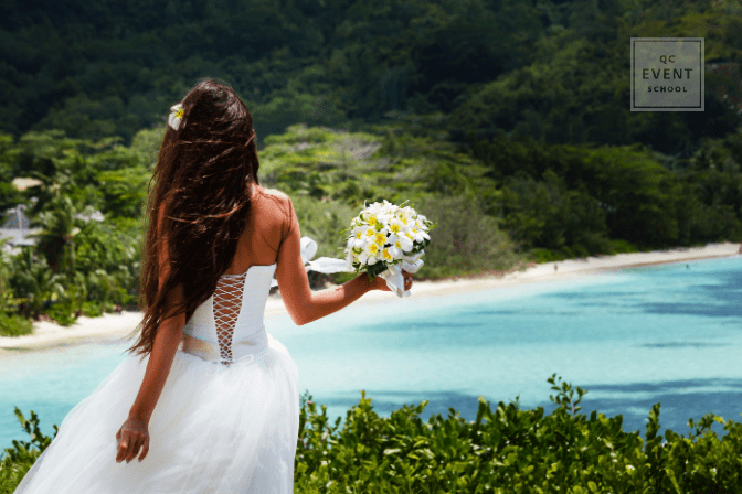 bride looking out at ocean during destination wedding
