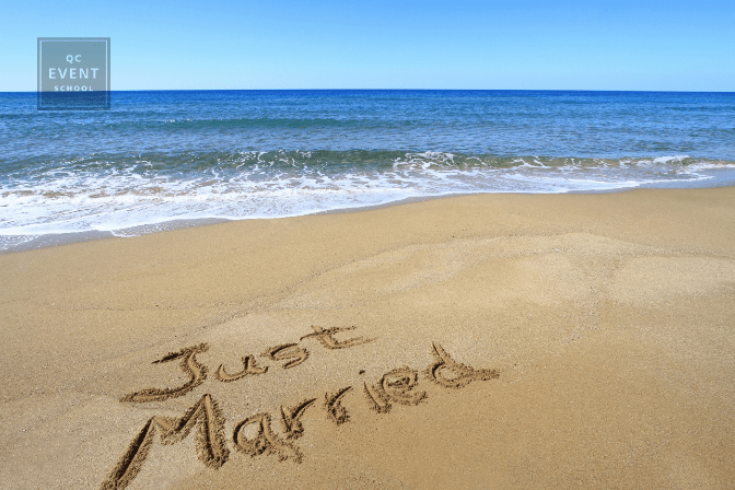 'Just Married' written on sand at the beach for destination wedding