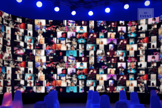 virtual event planning; blurred screen with hundreds of people on video conference call