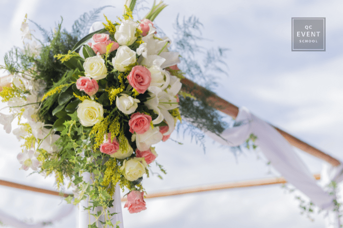 wedding and event planning decor - bouquet decorating outdoor wooden arch