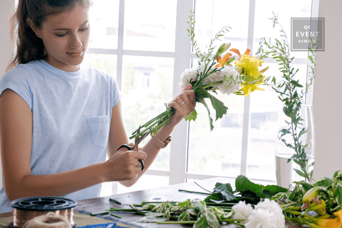 floral design expert clipping bouquet stems