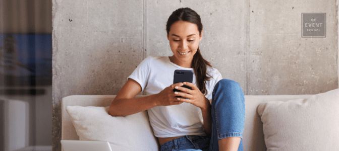 woman sitting on couch reading QC Pet Studies blog on phone