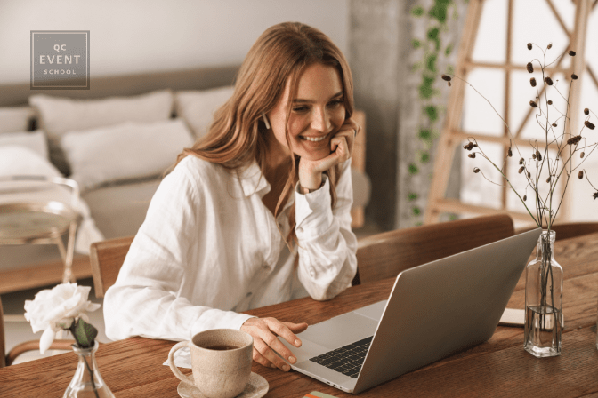 happy woman on laptop at home