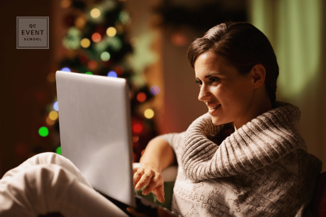 woman on laptop by christmas tree