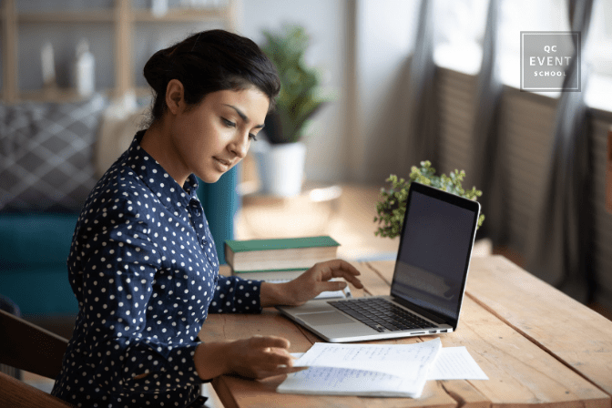 Businesswoman working on laptop at home
