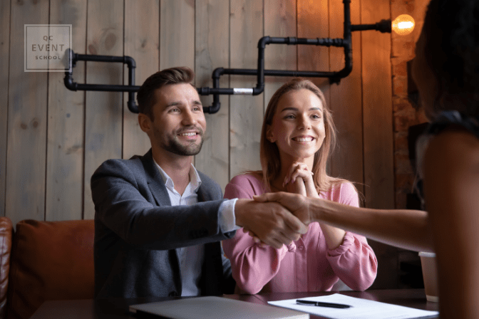 woman shaking hands with couple