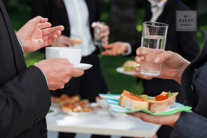 business employees eating and drinking outside at corporate event