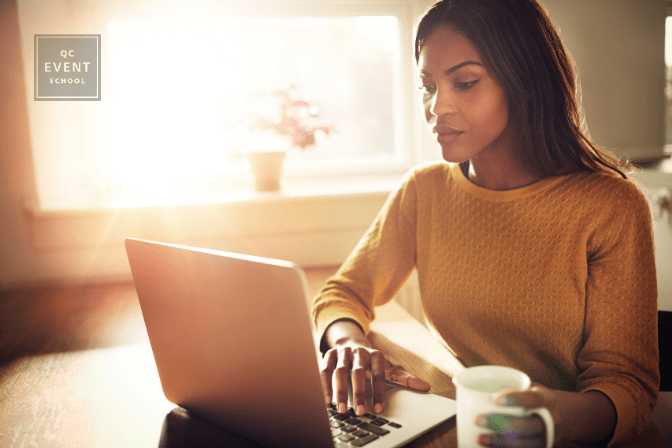 woman on laptop at home, doing wedding planning courses remotely