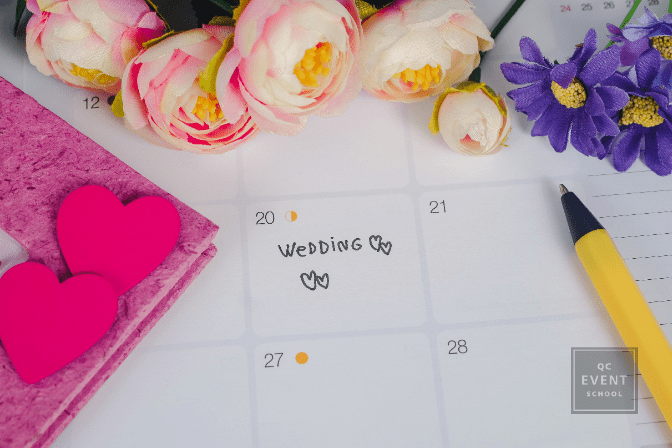 calendar surrounded by flowers, with wedding marked on date
