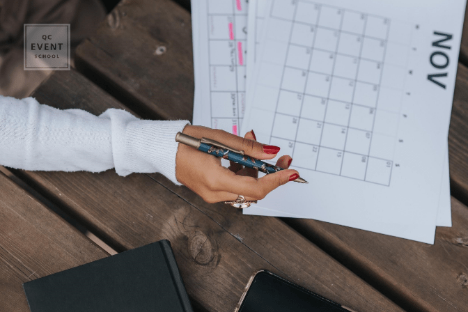 woman writing in calendar planner