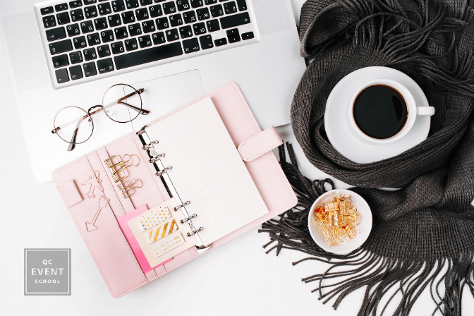 laptop, planner, scarf, and coffee on white table