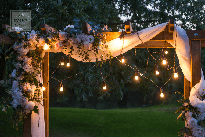 string lights on ceremony arch